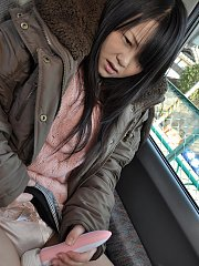 Japanese teen Syoko tries a sex toy in the car outdoors