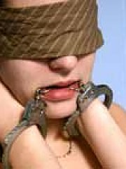 blindfolded and handcuffed (nudity)