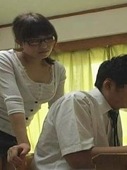 Jav Asian babe with specs strokes woody to get cum in her mouth