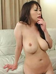Jav Asian busty gal sucks two boners and is fucked from behind