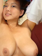 Taiwan Mega-Titty Star Kitty Kat reveals her school girl charms and a shaved pussy