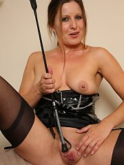 Mia in latex dress and tan stockings fucks herself with her riding crop.