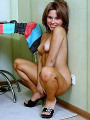 Brunette lifts dress to flash her goods