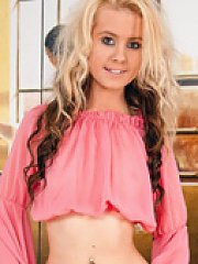 Cute blonde girl next door with braces plays with a vibrator